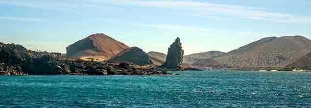 pinnacle rock seen from a boat in bartholomew island